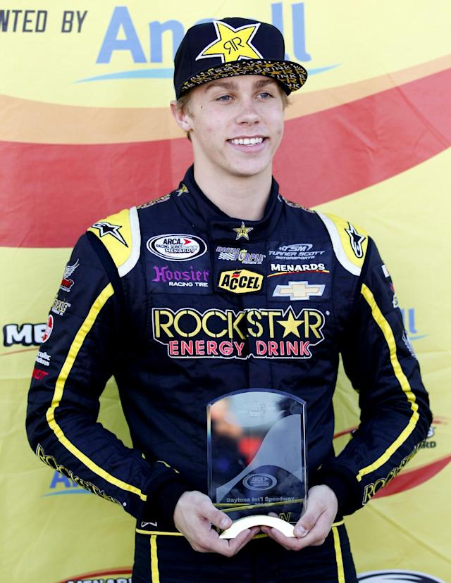 Driver Dylan Kwasniewski poses for photos with his trophy in the garages after winning the pole position for the ARCA Series race at Daytona International Speedway in Daytona Beach, Fla., Friday, Feb. 14, 2014. (AP Photo/Terry Renna)