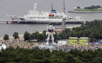 In this photo taken on July 18, 2009, eighteen-meter (60-foot) tall Gundam stands at a park in Tokyo's manmade Odaiba island, Japan. If anything can encourage busy Tokyoites to take notice of their city's bid to host the 2016 Olympics, it's a replica of the popular robot animation Mobile Suit Gundam, the Japanese anime series robot, big enough to take on Godzilla. (AP Photo/Koji Sasahara)