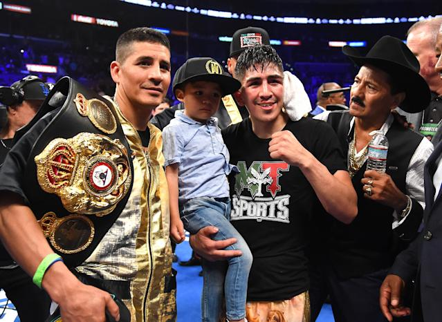 Antonio Santa Cruz (L), Leo Santa Cruz holding his son Al Santa Cruz and his dad Jose Santa Cruz (R) celebrate the defeat of Abner Mares (not pictured) at Staples Center on June 9, 2018 in Los Angeles, California. (Getty Images)