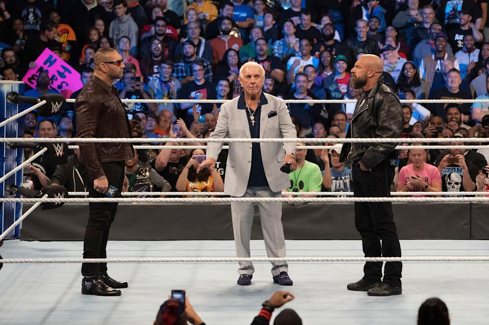Batista, Triple H, Ric Flair share an in-ring moment at WWE's 'Smackdown' 1000 in Washington, D.C. last October. (Photo courtesy of WWE)