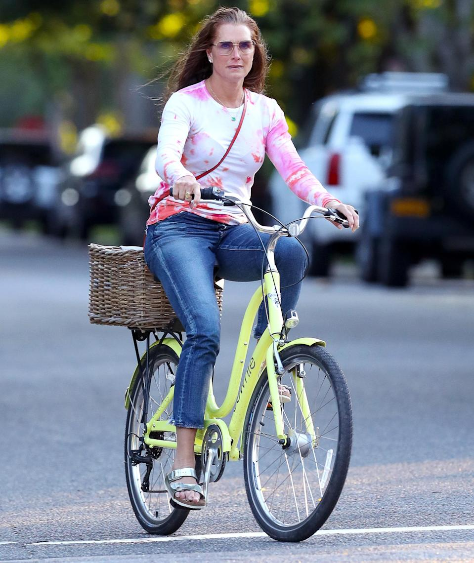 <p>Brooke Shields brightens up her Monday with a colorful bike ride through Southampton, New York. </p>