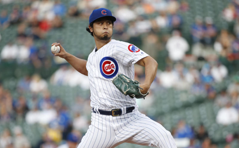 Chicago Cubs starting pitcher Yu Darvish delivers against the Colorado Rockies during the first inning of a baseball game Wednesday, June 5, 2019, in Chicago. (AP Photo/Kamil Krzaczynski)