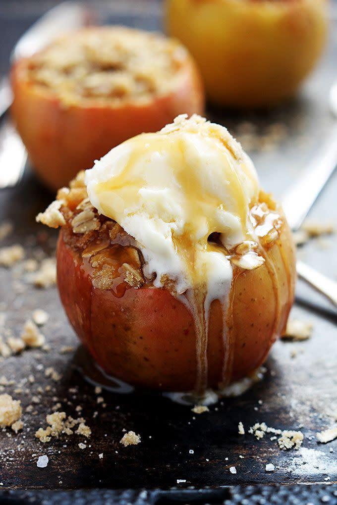 "<strong>Get the recipe for <a href=""http://lecremedelacrumb.com/2014/09/apple-crisp-stuffed-apples.html"" rel=""nofollow noopener"" target=""_blank"" data-ylk=""slk:apple crisp stuffed baked apples"" class=""link rapid-noclick-resp"">apple crisp stuffed baked apples</a> from Creme de la Crumb.</strong>"
