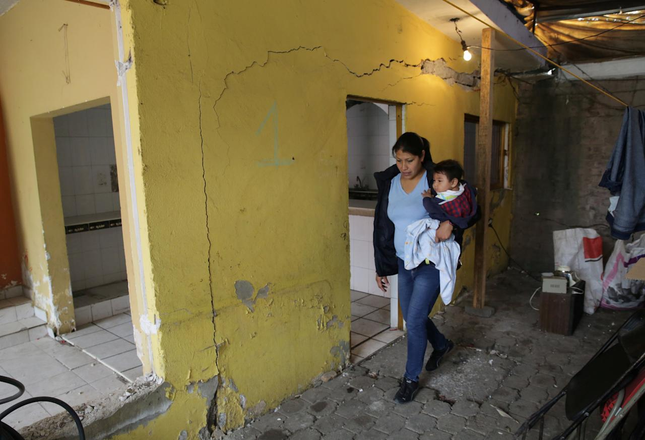 Ester Perea Rosendo, 31, holds her son as she leaves her damaged house, after the earthquake on September 19, in Santa Cruz Alcapixca neighbourhood in Mexico City, Mexico, October 18, 2017. REUTERS/Henry Romero