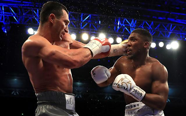 Anthony Joshua (right) took the fight to Wladimir Klitschko, which is exactly what the fans wanted - Getty Images Europe