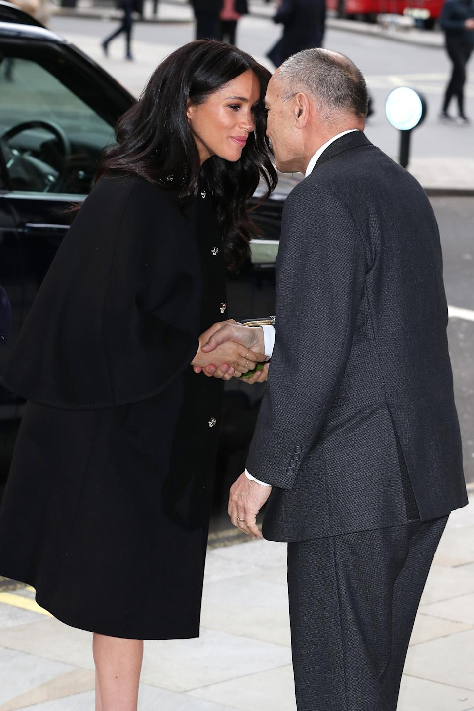 The duchess gives the hongi, a traditional maori greeting as she arrives at New Zealand House [Photo: Getty]