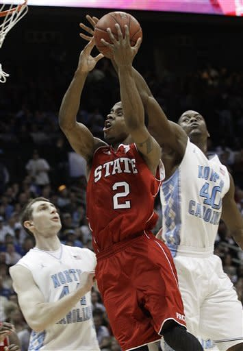 North Carolina State guard Lorenzo Brown (2) heads to the hoop under pressure from North Carolina forward Harrison Barnes (40) and forward Tyler Zeller (44) during the second half of an NCAA college basketball game in the semifinals of the Atlantic Coast Conference tournament, Saturday, March 10, 2012, in Atlanta. (AP Photo/Chuck Burton)