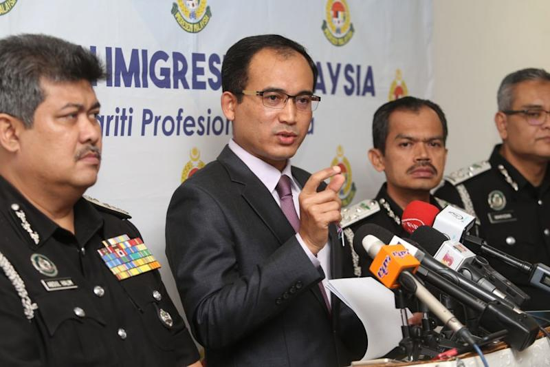 Immigration Department Director-General Datuk Khairul Dzaimee Daud speaks during a media conference in Putrajaya July 19, 2019. — Picture by Choo Choy May
