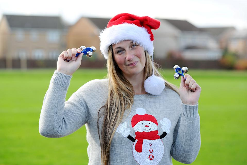 A bell ringing event organised to bring the community together at Christmas has gone viral, pictured organiser Lauren Sinclair. (SWNS)