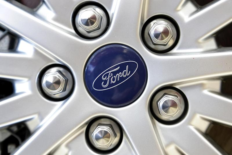 In this Wednesday, March 20, 2013 photo a Ford emblem is attached to the wheel of a sedan at a Ford dealership in, Norwood, Mass. March is turning out to be the best month for auto sales in at least six years. Major automakers including Ford, Chrysler, Toyota, General Motors and Nissan all reported increases, with some reporting their best month since the start of the Great Recession in December of 2007. (AP Photo/Steven Senne)
