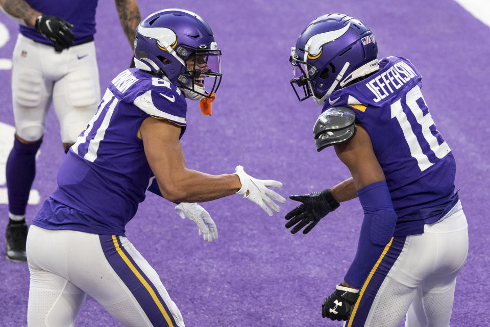 Justin Jefferson celebrates with Bisi Johnson of the Minnesota Vikings after scoring a touchdown. (Photo by Stephen Maturen/Getty Images)