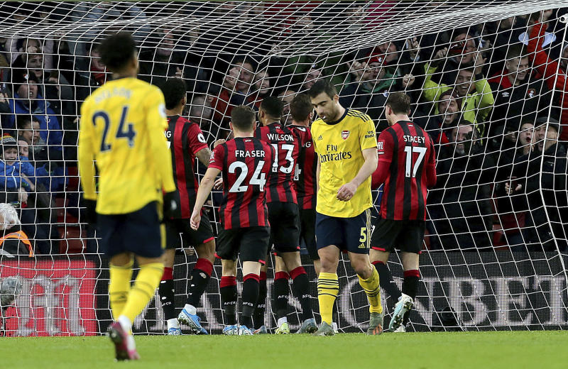 Bournemouth's Dan Gosling, center obscured, celebrates scoring his side's first goal of the game during their English Premier League soccer match against Arsenal at the Vitality Stadium, Bournemouth, England, Thursday, Dec. 26, 2019. (Mark Kerton/PA via AP)