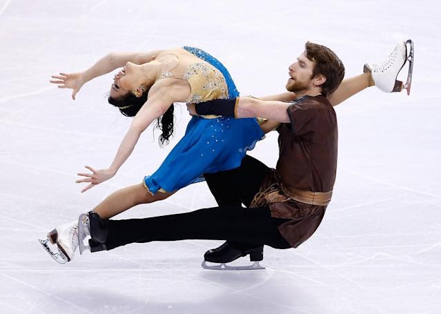 BOSTON, MA - JANUARY 11: Lynn Kriengkrairut and Logan Giulietti-Schmitt skate in the free dance program during the 2014 Prudential U.S. Figure Skating Championships at TD Garden on January 11, 2014 in Boston, Massachusetts. (Photo by Jared Wickerham/Getty Images)