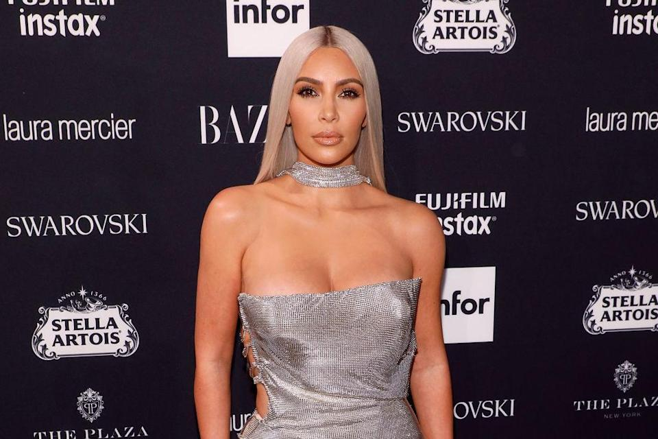 Kim Kardashian does a lot to take care of her bleached-blond hair. (Photo: Getty Images)