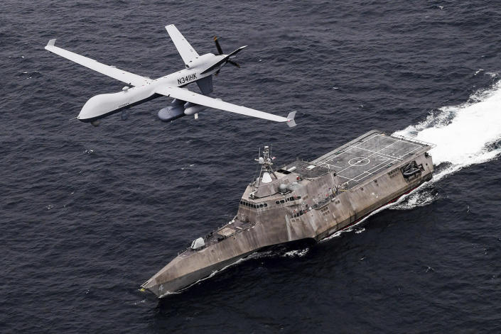 In this handout image from the U.S. Navy, an MQ-9 Sea Guardian unmanned maritime surveillance drone flies over the USS Coronado in the Pacific Ocean during a drill April 21, 2021. The U.S. Navy's Mideast-based 5th Fleet said Wednesday, Sept. 8, 2021, it will launch a new task force that incorporates airborne, sailing and underwater drones after years of maritime attacks linked to ongoing tensions with Iran. (U.S. Navy/Chief Mass Communication Specialist Shannon Renfroe, via AP)