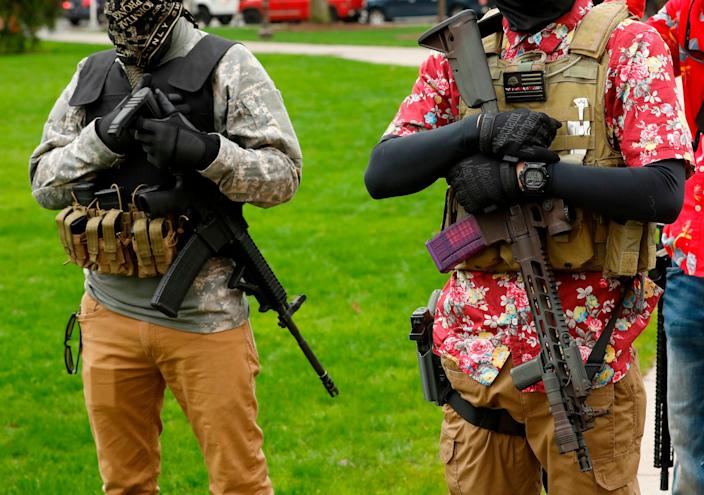 Armed protesters guard demonstrators at the Michigan State Capitol in April 2020. (AFP via Getty Images)