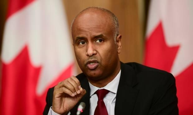 Minister of Families, Children and Social Development Ahmed Hussen announced the territory would be receiving $19.2 million to address housing issues in the N.W.T.   (Sean Kilpatrick/The Canadian Press - image credit)
