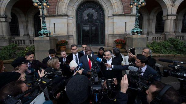 PHOTO: Gambia's Justice Minister Aboubacarr Tambadou comments outside the International Court in The Hague, Netherlands, Thursday, Jan. 23, 2020, after the court ordered Myanmar take all measures in its power to prevent genocide against the Rohingya. (Peter Dejong/AP)