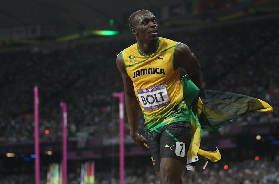 LONDON, ENGLAND - AUGUST 09: Usain Bolt of Jamaica celebrates after he wins gold during the Men's 200m Final on Day 13 of the London 2012 Olympic Games at Olympic Stadium on August 9, 2012 in London, England. (Photo by Ian MacNicol/Getty Images)