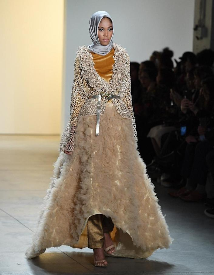 Indonesian fashion designer Anniesa Hasibuan collection features shimmering, on-trend pleats, silver and golden ruffles, and long trains adorned with pearls, glitter or embroidery (AFP Photo/Angela Weiss)