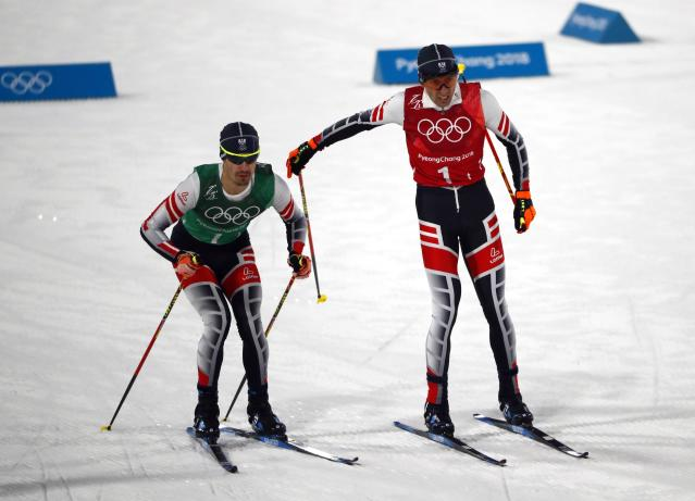 Nordic Combined Events - Pyeongchang 2018 Winter Olympics - Men's Team 4 x 5 km Final - Alpensia Cross-Country Skiing Centre - Pyeongchang, South Korea - February 22, 2018 - Wilhelm Denifl of Austria and Lukas Klapfer of Austria exchange. REUTERS/Dominic Ebenbichler