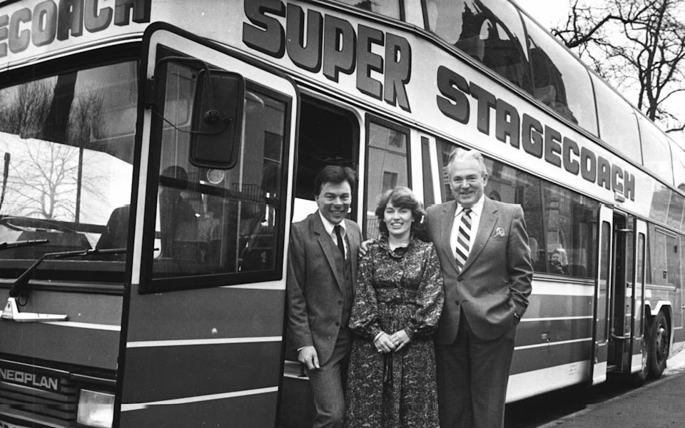 Brian Souter (left), his sister Ann and their uncle, Fraser McColl, in front of the company's first double-decker coach