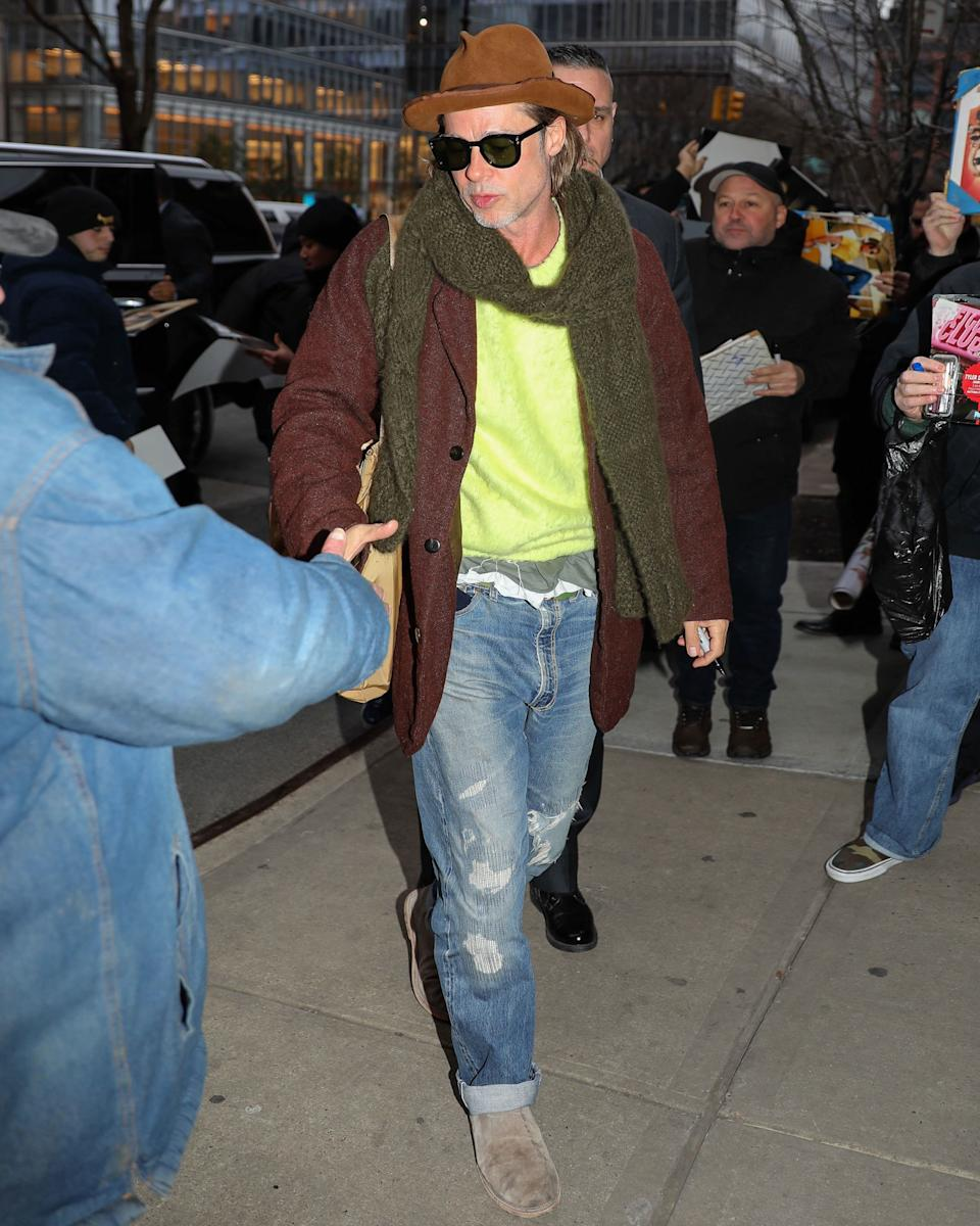 Wearing all neon is merely brave, while wearing neon and earth tones is a truly courageous Brad Pitt.