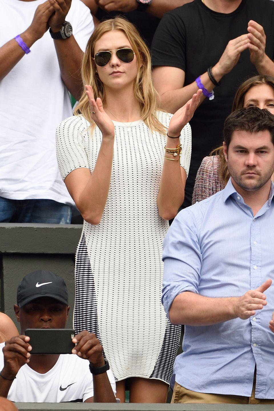 <p><strong>2015</strong> Karlie Kloss kept it classic in a white striped dress.</p>
