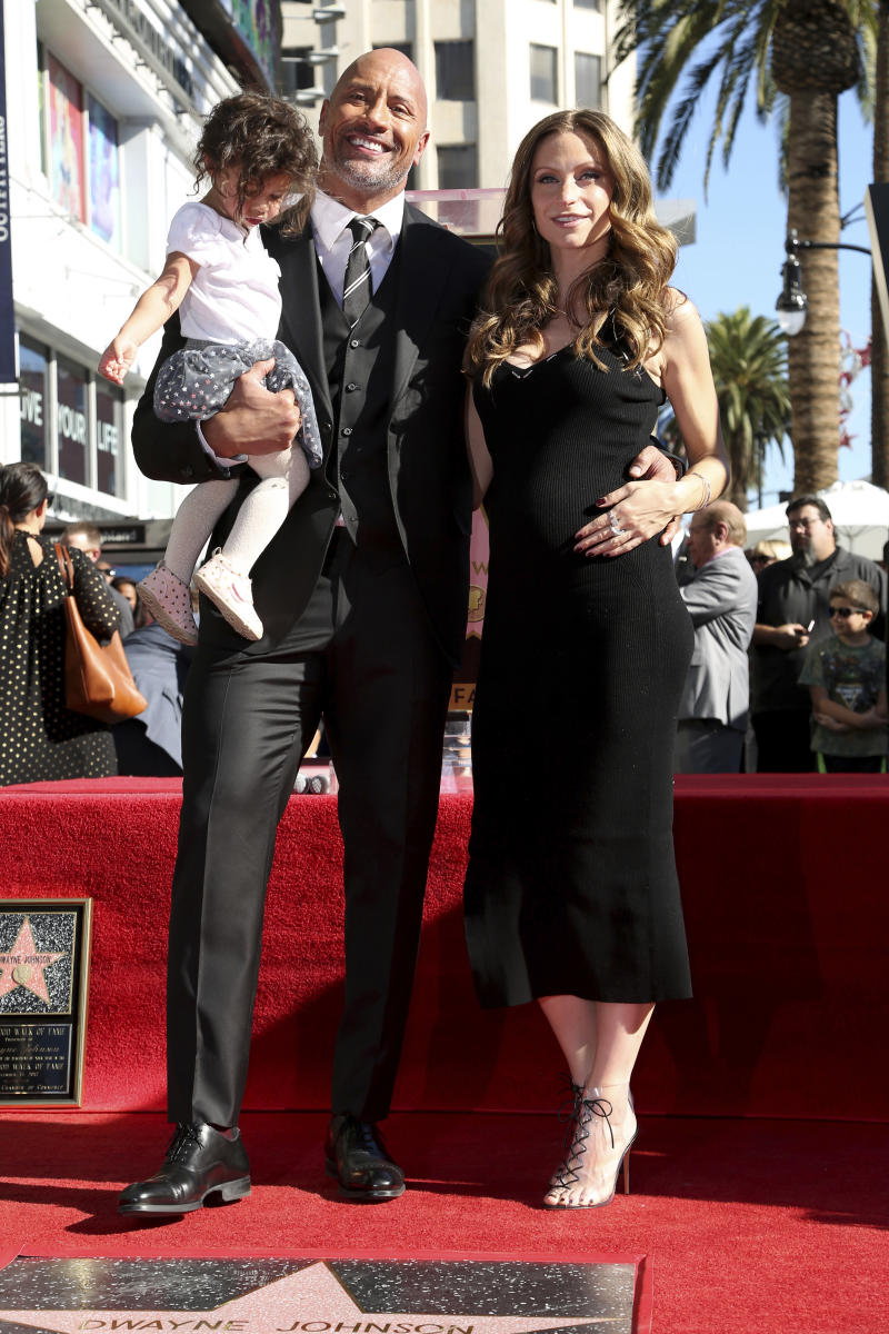 Lauren Hashian, right, Dwayne Johnson and their daughter Jasmine Johnson pose for a photo at a ceremony honoring him with a star on the Hollywood Walk of Fame on Wednesday, Dec. 13, 2017, in Los Angeles. (Photo by Willy Sanjuan/Invision/AP)