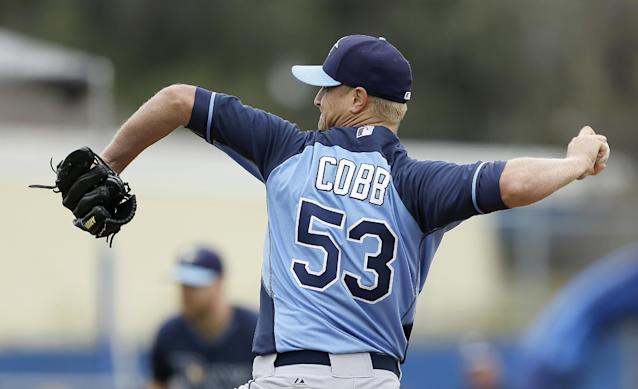 Tampa Bay Rays starting pitcher Alex Cobb throws a pitch during the first inning of an exhibition baseball game against the Toronto Blue Jays Friday, March 7, 2014, in Dunedin, Fla. (AP Photo/Charlie Neibergall)
