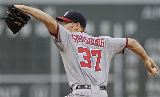 Washington Nationals starting pitcher Stephen Strasburg delivers to the Boston Red Sox during the first inning of a baseball game at Fenway Park, Friday, June 8, 2012, in Boston. (AP Photo/Charles Krupa)
