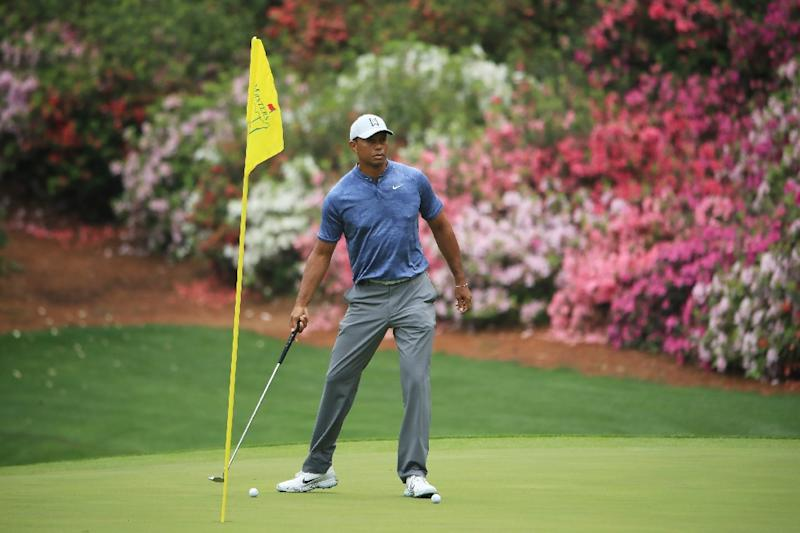 tiger tees off with rahm  li at masters  mcilroy next