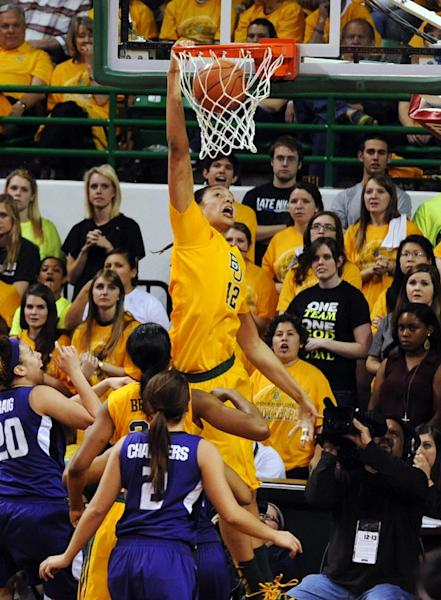 Baylor's Brittney Griner (42) dunks over Kansas State's Bri Craig (20) and Brittany Chambers (2) in the second half of their NCAA college basketball game, Monday, March, 4, 2013, in Waco, Texas. Baylor won 90-68. (AP Photo/The Waco Tribune-Herald, Rod Aydelotte)