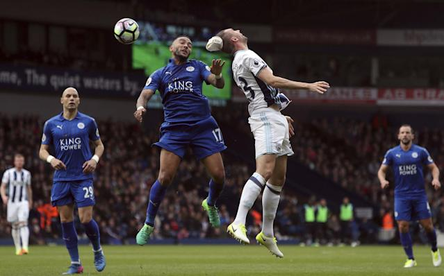 <p>West Bromwich Albion's Gareth McAuley, centre left, and Leicester City's Danny Simpson contest an aerial ball </p>
