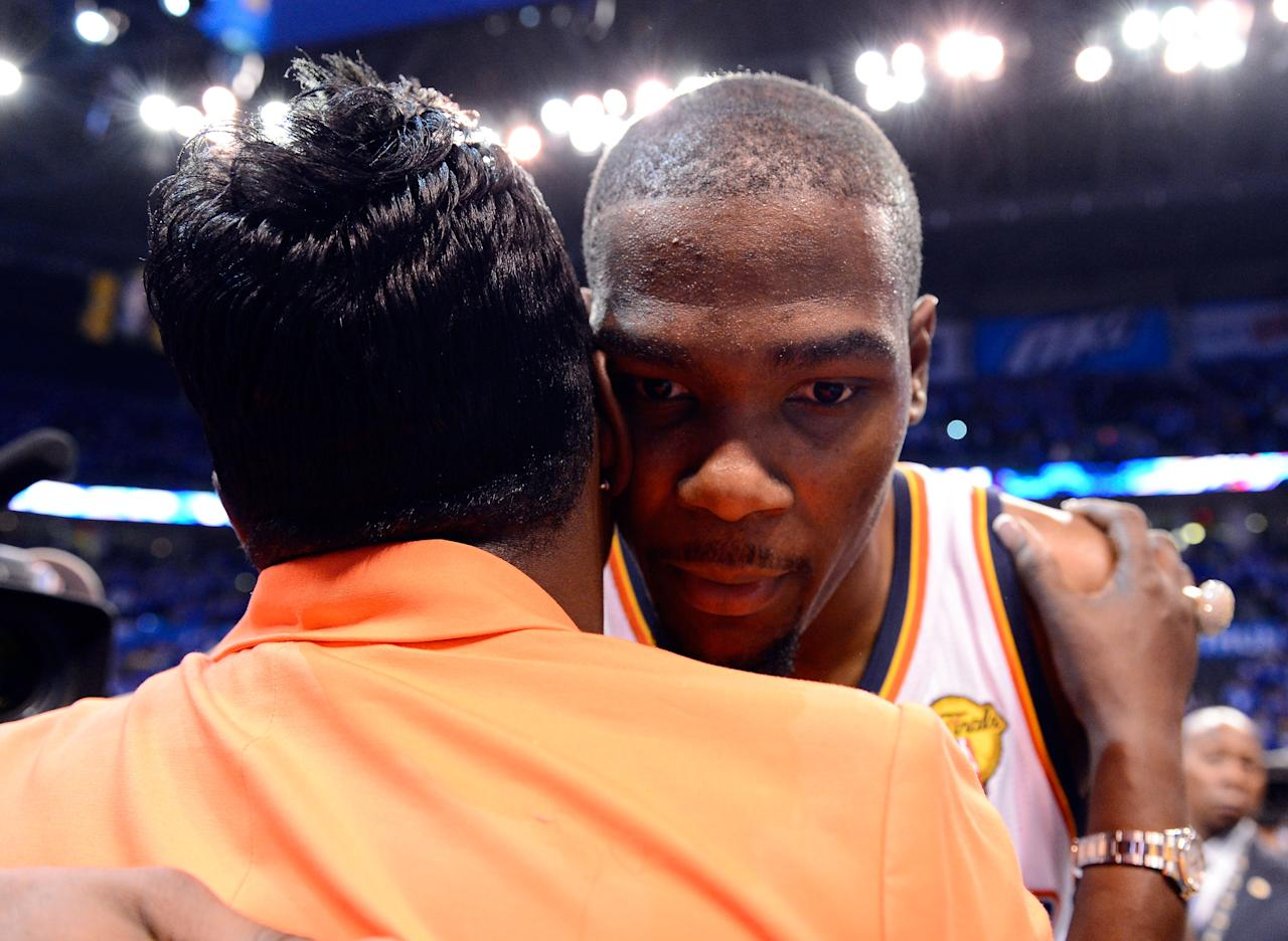 OKLAHOMA CITY, OK - JUNE 12:  Kevin Durant #35 of the Oklahoma City Thunder hugs his mother Wanda Pratt after the Thunder defeat the Miami Heat 105-94 in Game One of the 2012 NBA Finals at Chesapeake Energy Arena on June 12, 2012 in Oklahoma City, Oklahoma. NOTE TO USER: User expressly acknowledges and agrees that, by downloading and or using this photograph, User is consenting to the terms and conditions of the Getty Images License Agreement.  (Photo by Ronald Martinez/Getty Images)