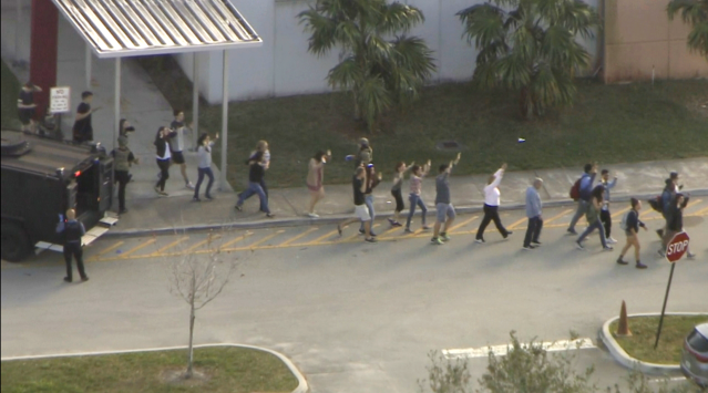 <p>Screengrab of the scene of a shooting at the Marjory Stoneman Douglas High School in Parkland, Fla., Feb. 14, 2018. (Photo: LocalABC10) </p>