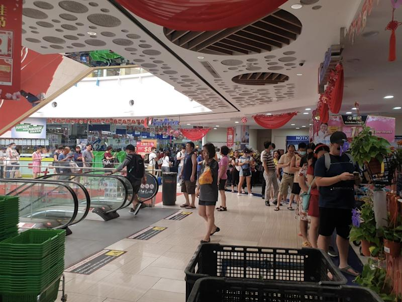 People queue for masks outside a NTUC Fairprice in Simei. Photo: Cindy Wong/Facebook
