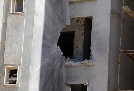 A hole in a house damaged by shelling during the fighting between the eastern forces and internationally recognized government is pictured in Abu Salim in Tripoli, Libya April 15, 2019. REUTERS/Hani Amara