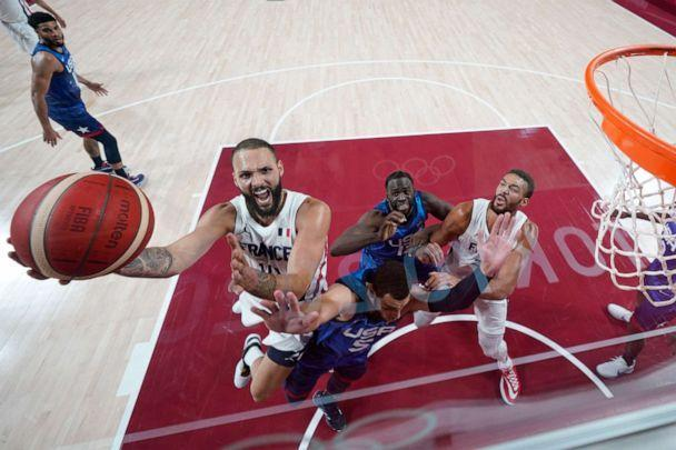 PHOTO: Evan Fournier #10 of Team France drives to the basket against Zachary Lavine #5 of Team United States during the first half of the Men's Preliminary Round Group B game on day two of the Tokyo 2020 Olympic Games. (Eric Gay - Pool/Getty Images)