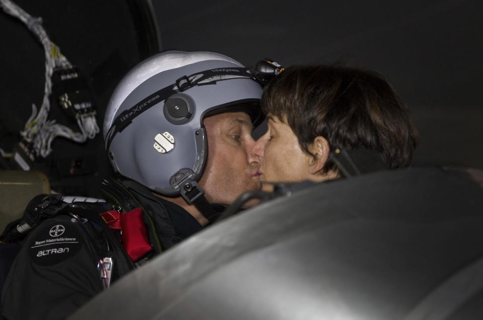 An experimental solar-powered airplane's pilot Bertrand Piccard kisses his wife Michele Piccard before his departure at Barajas airport in Madrid, Spain, Tuesday, June 5, 2012. The zero fuel airplane arrived in Madrid on May 25, 2012 from Payerne, Switzerland, and now goes on to Rabat, Morocco on its first transcontinental trip. The mission is described as the final dress rehearsal for a round-the-world flight with a new and improved aircraft in 2014. (AP Photo/Alberto Di Lolli)