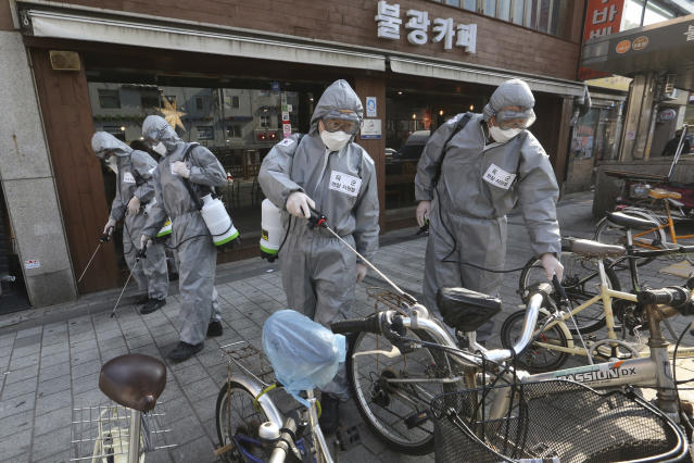 South Korean army soldiers spray disinfectant as a precaution against the new coronavirus on a street in Seoul, South Korea. (AP)