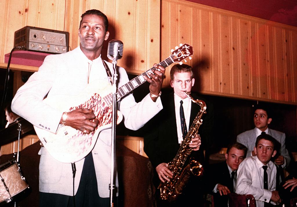 <p>Rock and roll musician Chuck Berry plays electric guitar as he performs with his band in 1956. (Photo by Michael Ochs Archives/Getty Images) </p>