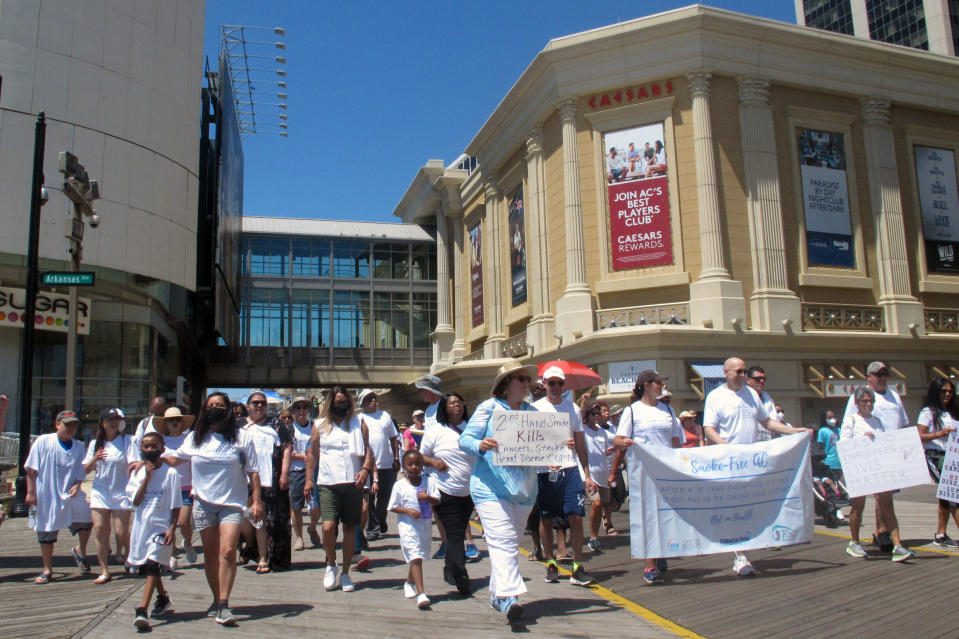 Casino workers and smoking opponents march on the Atlantic City N.J., Boardwalk on Wednesday, June 30, 2021 calling for a permanent ban on smoking in Atlantic City's nine casinos. The coronavirus-inspired temporary ban will expire on Sunday July 4. (AP Photo/Wayne Parry)
