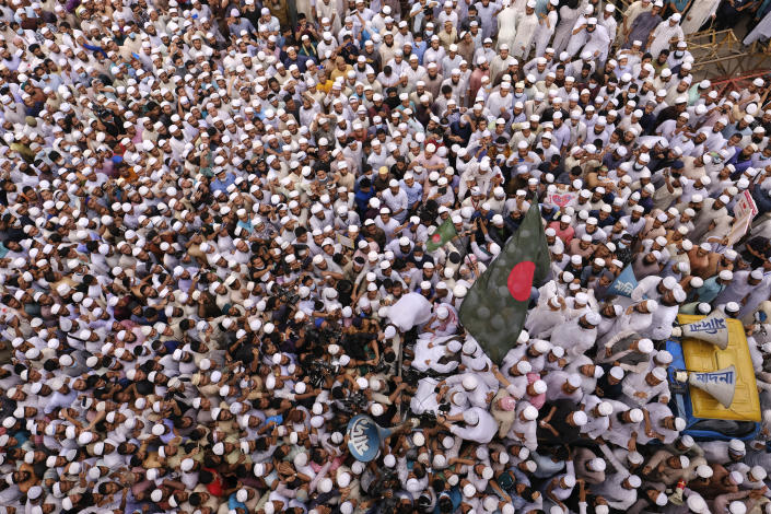 Thousands of Bangladeshi Muslims protesting the French president's support of secular laws allowing caricatures of the Prophet Muhammad march to lay siege on the French Embassy in Dhaka, Bangladesh, Monday, Nov.2, 2020. (AP Photo/Mahmud Hossain Opu)