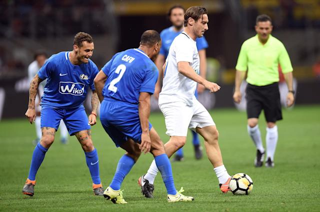 Former AS Roma player Francesco Totti in action during Andrea Pirlo's farewell soccer match at the San Siro stadium in Milan, Italy, May 21, 2018. REUTERS/Daniele Mascolo