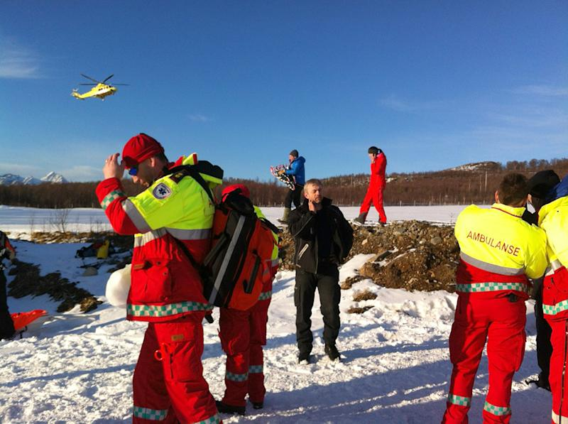 Rescue personnel prepare Monday March 19, 2012 to go to the mountain area near Kafjord, Norway where an avalanche is reported to have buried 6 tourists. Police said that preliminary information suggests the tourists were French and that they were part of a group of 12 people out skiing Monday near Tromsoe on Norway's Arctic coast. Police and military helicopters were dispatched to the area. (AP Photo/ Ola Solvang / Scanpix)