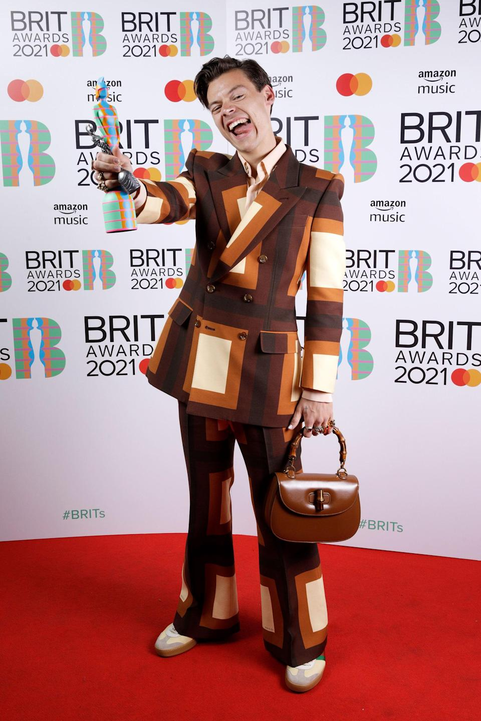 """<h2>Harry Styles in Gucci</h2><br>For once, we truly cannot find the words to describe how perfect this suit — pulled from <a href=""""https://www.refinery29.com/en-us/2021/04/10422889/gucci-balenciaga-aria-show-2021"""" rel=""""nofollow noopener"""" target=""""_blank"""" data-ylk=""""slk:Gucci's Aria show"""" class=""""link rapid-noclick-resp"""">Gucci's Aria show</a> — is on Harry Styles. Big props to his stylist Harry Lambert. <span class=""""copyright"""">Photo: JMEnternational/Getty Images.</span>"""