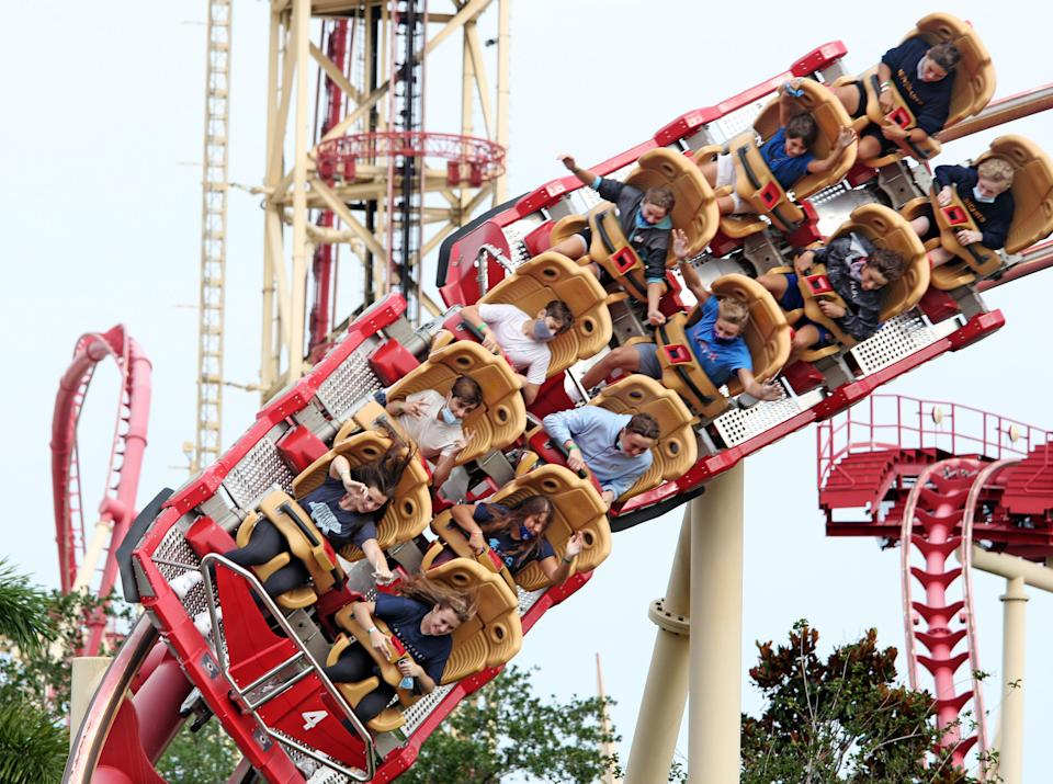 Visitors ride a roller coaster at Universal Studios theme park on the first day of reopening from the coronavirus pandemic, on June 5, 2020, in Orlando, Florida. (Photo by Gregg Newton / AFP) (Photo by GREGG NEWTON/AFP via Getty Images)