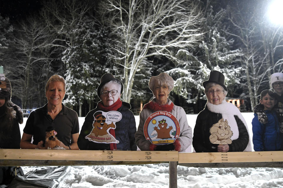 Cardboard cutouts of groundhog enthusiasts decorate Gobbler's Knob for the 135th celebration of Groundhog Day in Punxsutawney, Pa., Tuesday, Feb. 2, 2021. This year's event was held without anyone in attendance due to potential COVID-19 risks. (AP Photo/Barry Reeger)