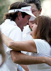 Bubba Watson hugs his mother, Molly, after winning the sudden death playoff